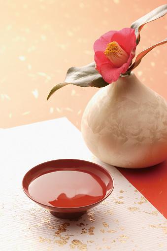 Sake「Pink camellia next to a cup of saki」:スマホ壁紙(3)