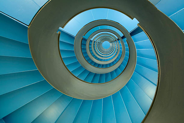 Spiral staircase with endless blue facets:スマホ壁紙(壁紙.com)