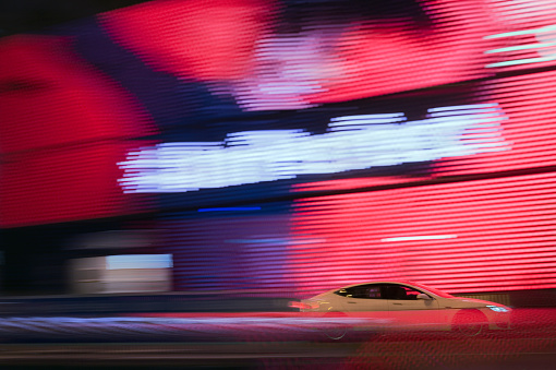 Wealth「Luxury car passing enormous LED screen in Hong Kong」:スマホ壁紙(14)