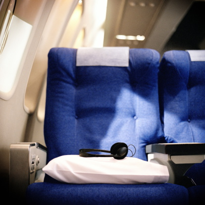 Pillow「Pillow and headphones on seat in airliner」:スマホ壁紙(0)