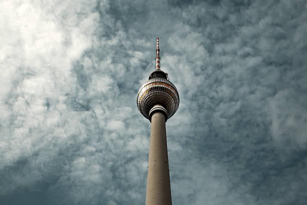Berlin's TV Tower against a cloudy sky:スマホ壁紙(壁紙.com)
