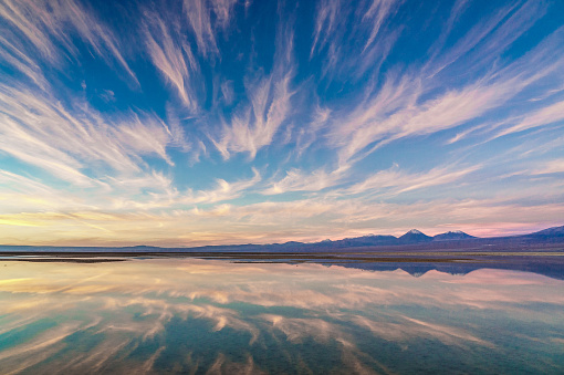 Awe「Pink sunset over and reflected in Laguna Chaxa, Atacama Salt Flats, with snow-capped volcanoes in thebackground, near San Pedro de Atacama, Chile」:スマホ壁紙(9)