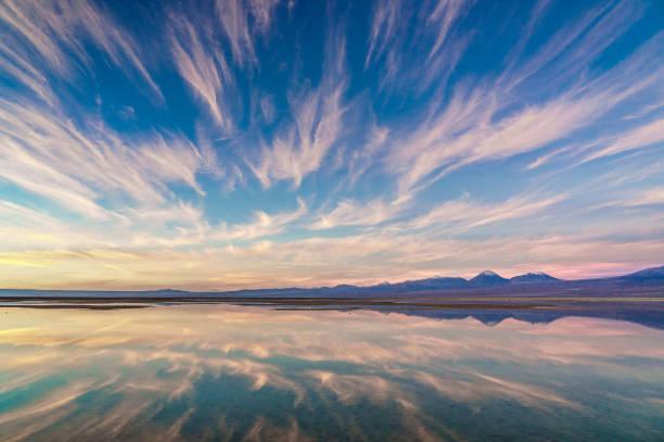 Pink sunset over and reflected in Laguna Chaxa, Atacama Salt Flats, with snow-capped volcanoes in thebackground, near San Pedro de Atacama, Chile:スマホ壁紙(壁紙.com)