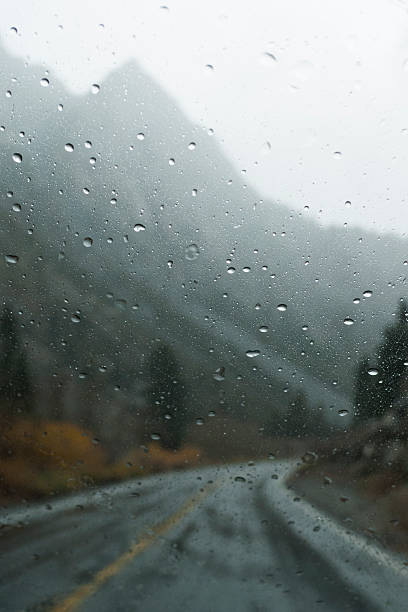 Mountains and rural road through wet window:スマホ壁紙(壁紙.com)