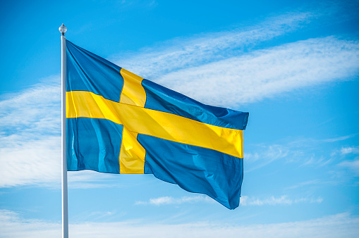 Swedish Culture「Swedish nation flag in sunlight」:スマホ壁紙(16)