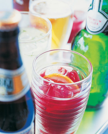 Cocktail「Glass of Punch With Ice Cubes and Various Bottles」:スマホ壁紙(11)