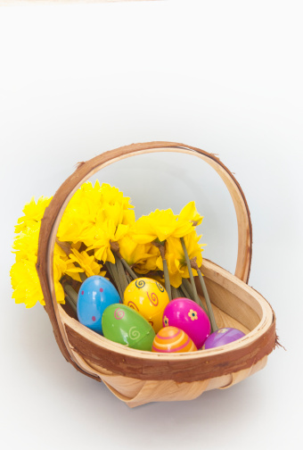 Easter Basket「a basket of yellow flowers and plastic easter eggs」:スマホ壁紙(16)