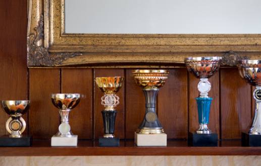 Championship「Row of trophies displayed on mantlepiece, close-up」:スマホ壁紙(15)