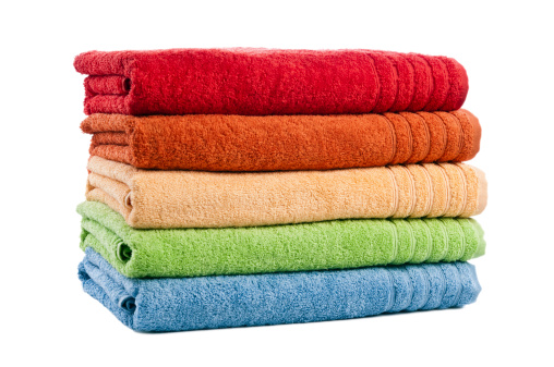 Laundry「Five stacked multicoloured bath towels isolated on white background, studio」:スマホ壁紙(1)