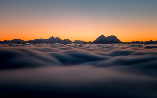 雲「Austria, Mountain peaks above clouds as seen from Gaisberg near Salzburg」:スマホ壁紙(18)