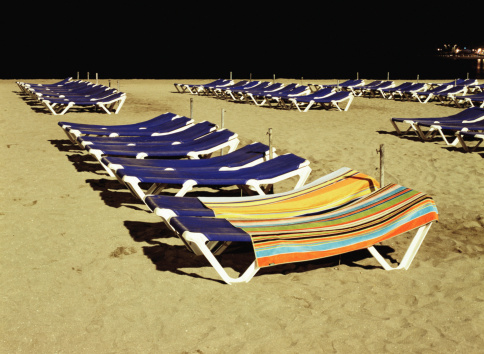 Atlantic Islands「Rows of sun loungers on beach, two covered with towels, night」:スマホ壁紙(2)