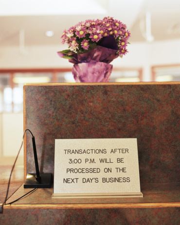 Bank Counter「Bank  transaction sign on counter, potted flower on top」:スマホ壁紙(5)