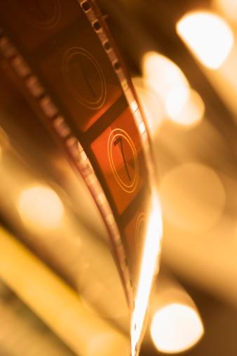 Sepia Toned「Film frames with light shining through」:スマホ壁紙(8)