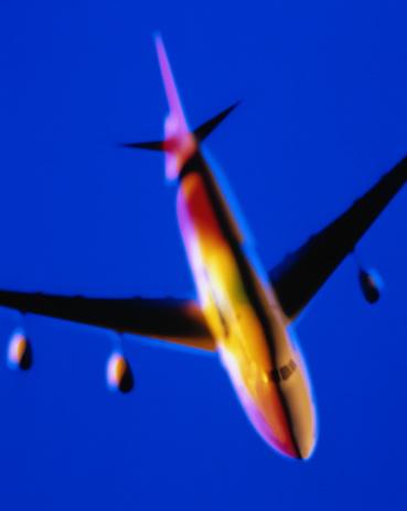 Passenger「Passenger plane on blue background, colourfully lit model,blurred」:スマホ壁紙(8)