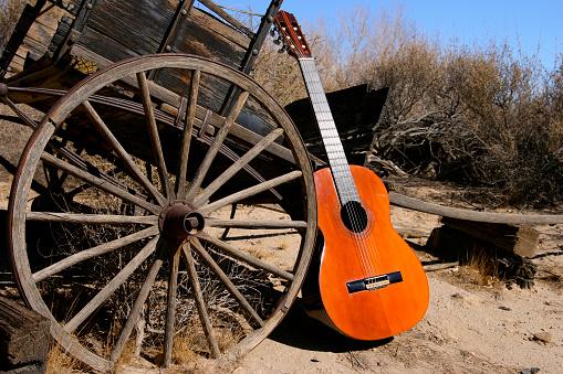 Folk Music「Old Classical Guitar in Western Scene with Wagon Wheel」:スマホ壁紙(15)