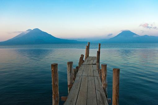 Lake Atitlan「Pier on Lake Atitlan with view of volcanoes」:スマホ壁紙(18)