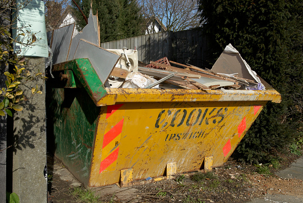 Yellow「Yellow skip full of rubbish on side of house under refurbishment」:写真・画像(11)[壁紙.com]
