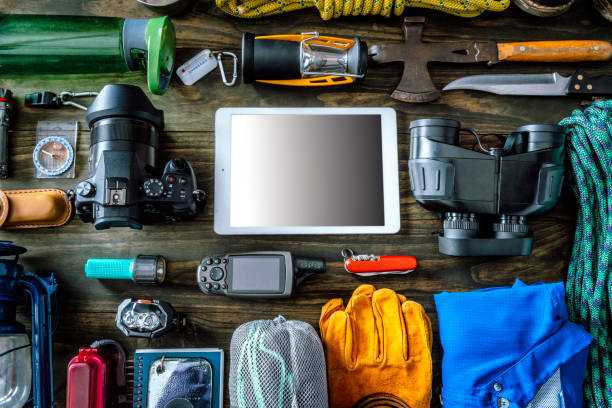 Travel equipment and accessories for mountain hiking trip on wood floor. Space for text into digital tablet.:スマホ壁紙(壁紙.com)