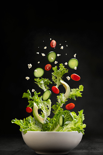 Greek Food「Salad ingredients flying through the air, landing in a bowl」:スマホ壁紙(16)