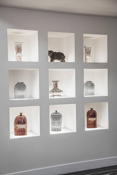 Built in shelves with an assortment of vases.:スマホ壁紙(壁紙.com)
