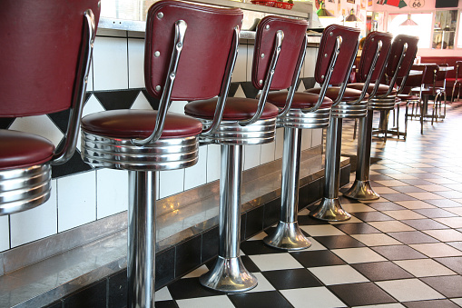 1950-1959「A line up of red diner style chairs 」:スマホ壁紙(5)