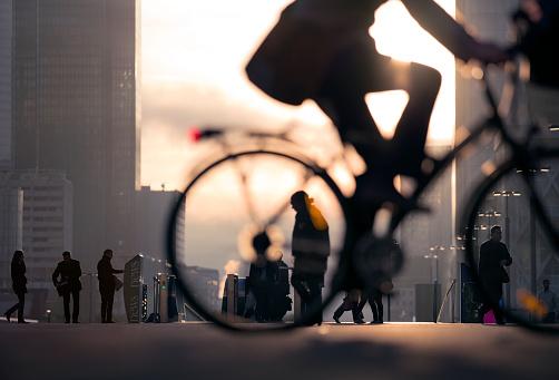 Incidental People「Businessman on bicycle passing skyline La Defense」:スマホ壁紙(6)