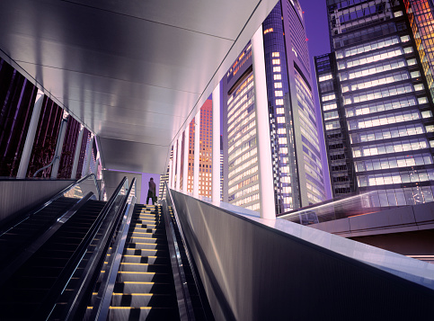 Finance and Economy「Businessman on top of moving escalator at modern illuminated business district」:スマホ壁紙(16)