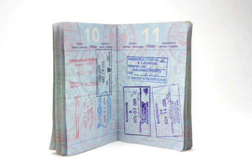 Leaving「Open passport with stamps on white background」:スマホ壁紙(14)