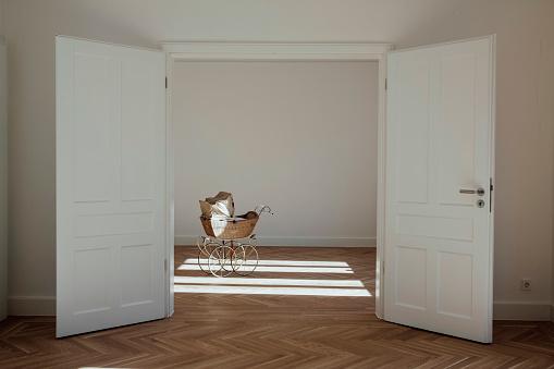 Baby Carriage「Pram in empty room, open doors」:スマホ壁紙(5)