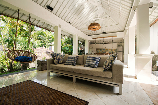 Fashion「Open living area in a tropical luxury home with couch and hanging chair」:スマホ壁紙(12)