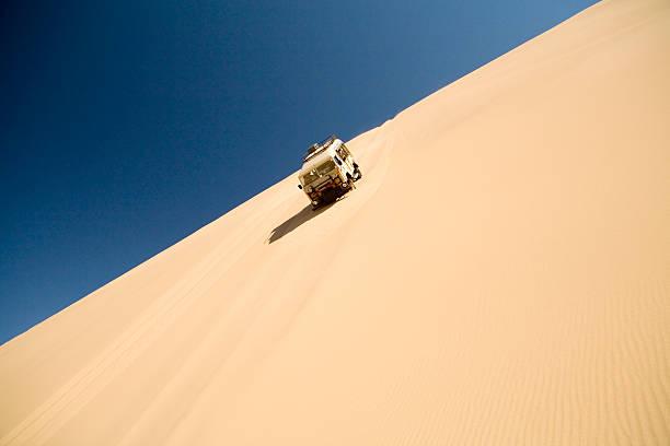 Off road vehicle driving down steep sand dune, Swakopmund, Namibia:スマホ壁紙(壁紙.com)