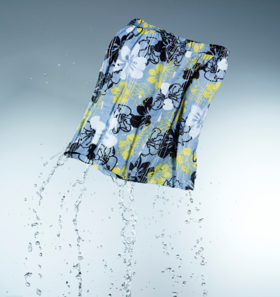 Floral Pattern「Swimming shorts on coloured background, close up」:スマホ壁紙(11)