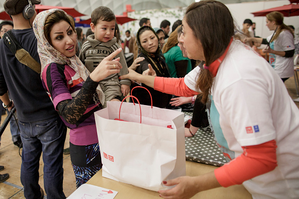 Charity and Relief Work「Uniqlo Donates 50,000 Articles Of Clothing To Refugees」:写真・画像(7)[壁紙.com]
