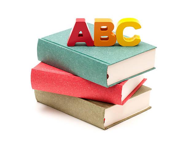 School Books and Alphabet isolated on white background:スマホ壁紙(壁紙.com)