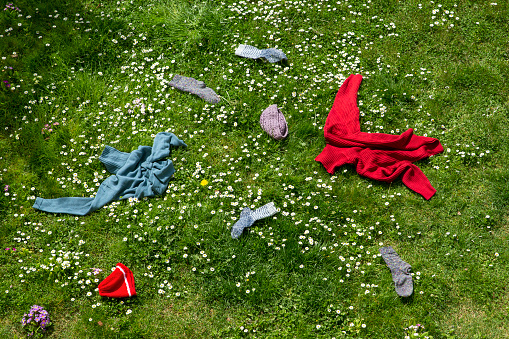 Warm Clothing「Winter clothes lying scattered in spring meadow」:スマホ壁紙(5)