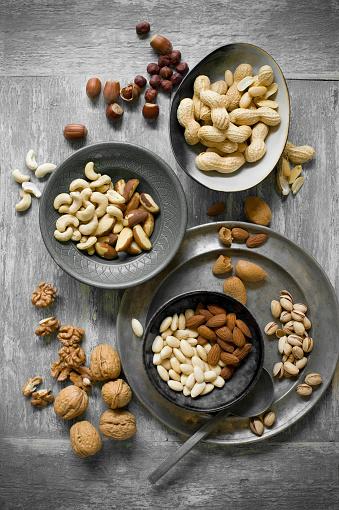 Gray Background「Peanuts, hazelnuts, cashew nuts, brazil nuts and almonds」:スマホ壁紙(2)