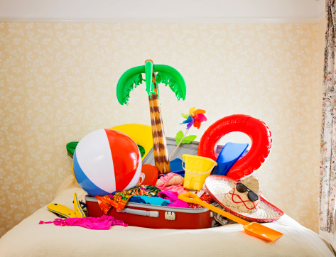 Journey「suitcase full of inflatable holiday props on bed」:スマホ壁紙(7)