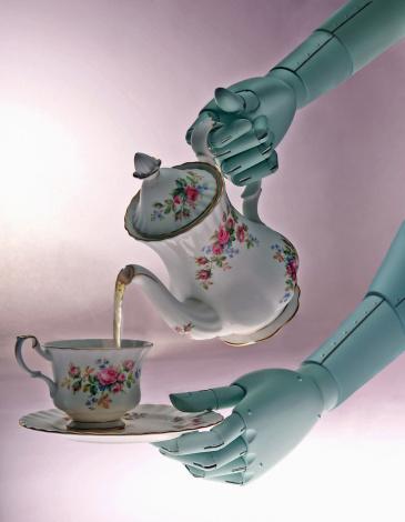 Teapot「Robotic hands pouring tea from teapot into antique teacup, close-up」:スマホ壁紙(15)