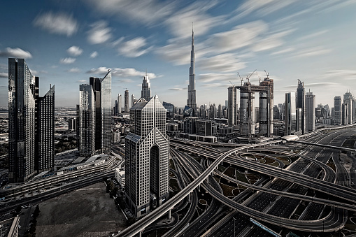 Multiple Exposure「Skyline of Dubai, UAE. Futuristic modern architecture of a big city - long time exposure with a large highway intersection.」:スマホ壁紙(2)