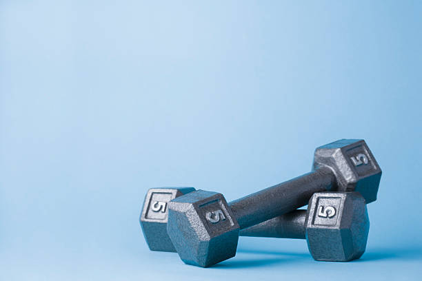 Pair of dumbbells on blue background:スマホ壁紙(壁紙.com)