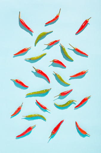 Vegetables「Green and red chilli peppers on blue background」:スマホ壁紙(2)