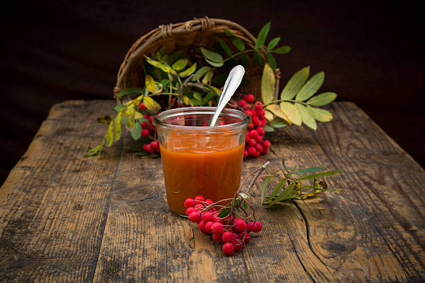 Wickerbasket, rowanberries and glass of rowanberry jam on dark wood:スマホ壁紙(壁紙.com)