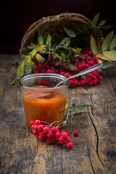 Wickerbasket, rowanberries and glass of rowanberry jam on dark wood:スマホ壁紙(壁紙.com)
