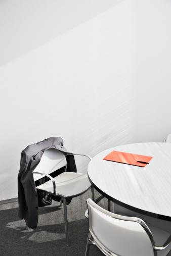 Coffee Break「Suit jacket in empty conference room」:スマホ壁紙(13)
