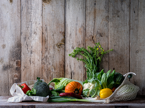 Wood Paneling「Market fresh vegetables sitting in rusable cotton bags on an old wood board table against an old wooden panel wall background」:スマホ壁紙(6)