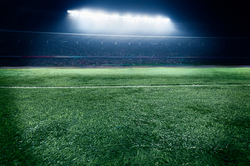 Soccer Field「Low angle view of sports field in stadium at night」:スマホ壁紙(17)