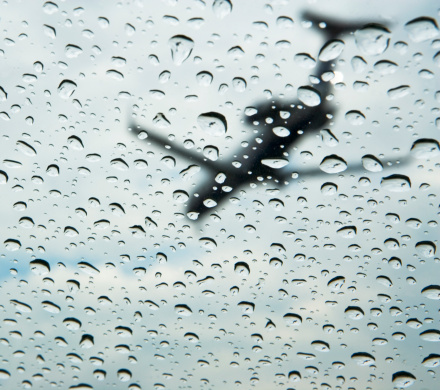 Passenger「Low angle view of airplane through rain drops on window」:スマホ壁紙(17)