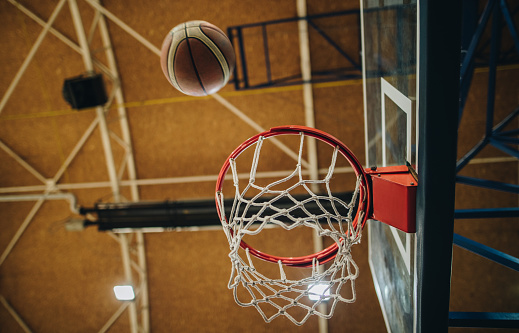 Sports Training「Low angle view of basketball hoop with a ball.」:スマホ壁紙(0)