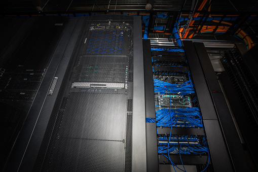 Data Center「Low angle view of server room racks glowing from behind」:スマホ壁紙(18)