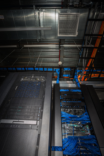 Data Center「Low angle view of server room racks glowing from behind」:スマホ壁紙(15)